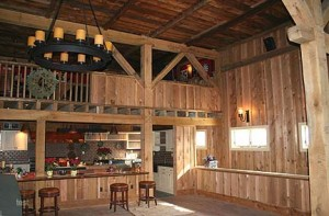 This 20th century dairy barn conversion for recreational use required the repair of the existing timber frame and the construction of significant additional timber framing.