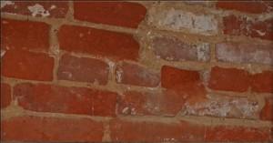 Masonry Repairs of Brick Warehouse Before Repairs (Photo Courtesy of Fitzgerald's Heavy Timber Construction, Inc., 2008).