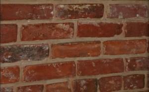 Masonry Repairs of Brick Warehouse During Repairs (Photo Courtesy of Fitzgerald's Heavy Timber Construction, Inc., 2008).