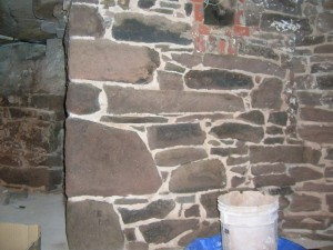 Areas of the building's blue stone foundation (both interior and exterior) were re-pointed using a raked joint.