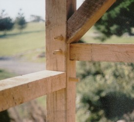 Timber frame post joinery detail. Pegs to be cut flush to accomodate finish surfaces.