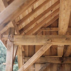Interior view of board wall.  Note timber framing joinery details.