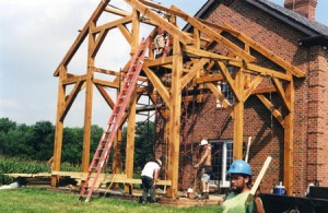 Assembled frame, a harmonious period style addition to a brick residence.