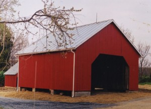 Kingsley Corncrib, after extensive restoration. Center bay is for equipment storage, a traditional layout. The new standing seamed sheet metal roof was produced by our own roofing sheet metal crew.