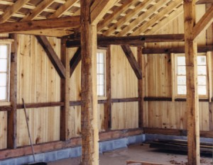 """View of finished project interior, assembled and sheathed. Note the look and """"feel"""" of original historic work in this brand new timber frame."""