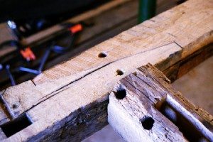 Timber frame splice detail in new joinery cut from salvaged and remilled timbers. Note the credible period look of the salvaged material.