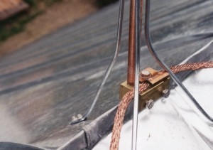 Lightning protection detail on the Dahlgren barn restoration project, showing grounding of new metal roof. Also shows treatment of ridge and standing seam terminations.