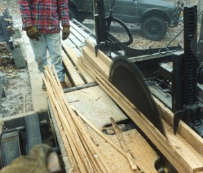 Sawing a stack of plaster lathe on the mill.