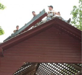 Workers remove the old roof from the Roddy Creek covered bridge. Fitzgerald's Heavy Timber Construction Inc. lead the effort, along with 20 volunteers.   (Bill Ryan photo)