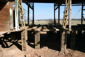 Barn Bridge Wall Removed for Reconstruction -- Barn Rests On Cribbing Stacks