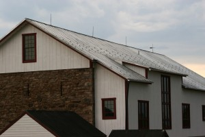 Finishing Touches -- Traditional Copper Lighting Suppression System Installed on Standing Seam Roof