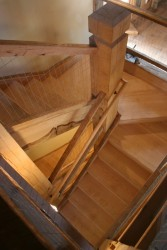 A Custom Box Winder Staircase Blends High-Finish Elemetns With Rough Heavy Timbers