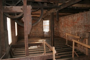 Second Floor -- Antique Elevator in Foreground Will Be Retained to Preserve Historic Character of the Building