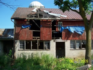 Before Construction -- Major Deterioration of the Roof, Wall, and Interior Framing