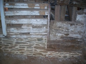Relaid and Repointed Interior Masonry Bearing Walls Support Repaired Log Partition