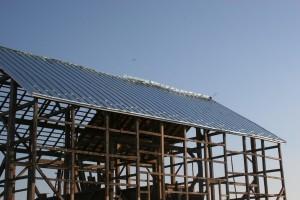 Roof Pans Installed -- Ridge Seam Forming In Progress