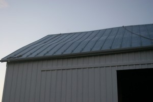 Hand-Seamed Roof Follows The Profile of the Old Rafters, Letting the Barn's Historic Character Shine Through