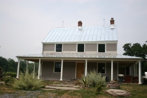 Roof Complete and Lightning Suppression System Installed -- Galvanized Metal will Dull to a Mild Grey Within a Month