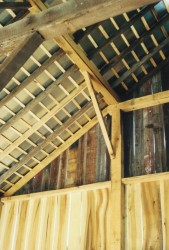 New and Old Framing Against the New Siding of the Bank Barn