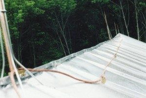 Traditional Standing Seam Roof With Lightning Suppression System -- Variations In the Antique Framing Give A Very Organic Feel