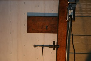 Smokehouses traditionally sored one of a family's most valuable assets -- their food -- so a stock lock secures the door against bandits and rogues.