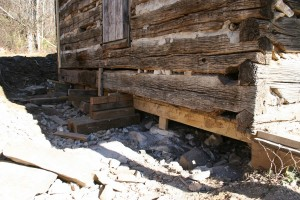 Beginning sill log replacements and foundation repairs.