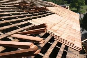 """West side shingles in progress, showing triple coverage of highest-grade 24"""" clear cedar shingles."""
