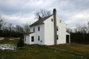 A poorly built lean-to addition and a dilapidated concrete front porch had been added over the years.