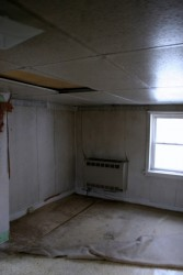 The interior had been covered in wallpaper, ceiling paneling, and various moldering floor coverings.