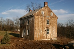 The old siding shows signs of whitewash from generations ago.
