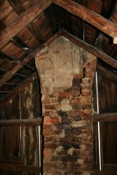 One of the two chimneys was so eroded that it was possible to reach into the flue from inside the attic.