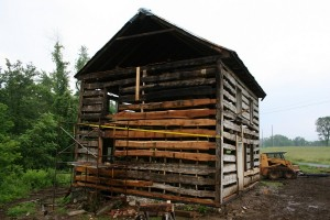 The fire-damaged area is reconstructed with new logs, tenoned into the corner post as the originals were.