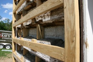 Where the gaps between the logs were originally filled with rubble, bits of wood, and mortar, we'll fill those spaces with insulating foam.
