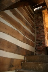 The interior of all walls are chinked with new historically sensitive mortar.  This is the fire-damaged area, good as new!
