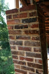 Now is the time to reconstruct the chimneys.  Notice the string-lines used to ensure we follow the same slant as the original chimney.