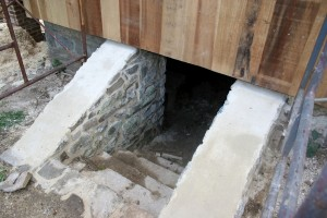 Masonry repairs include repointing and capping the basement entrance areaway walls.