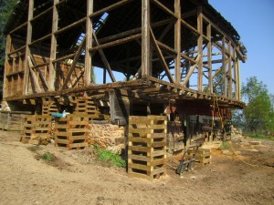 """Plenty of heavy """"cribbing"""" helps us level the barn floor back out before we install new posts to support it."""