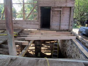 Often, after the large barn doors are gone, the floor joists in the threshing bay are in need of replacement.