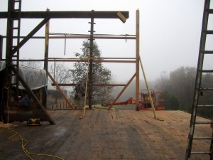 A level and well supported deck allows us to begin to replace missing upper posts, braces, and girts.