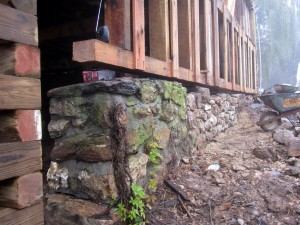 Foundation side-wall in place -- ready for the mason to reconstruct and repair the stone foundation wall that carries it.