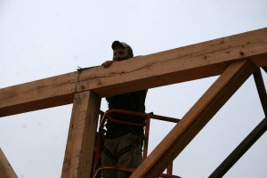 Fitting and securing a post, plate, and braces.