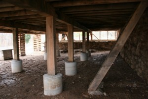 With all interior piers poured and posts set, most of the temporary cribbing can be removed.