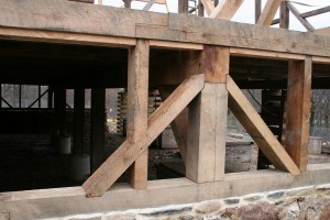 This unique bracing form helps the summer beams resist any thrust or roll from the earth ramp of the barn bridge.