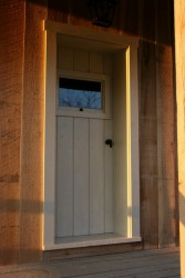The doors are constructed of beaded tongue-and-groove boards and strong-backs, clinch nailed.  The depth of the jambs makes apparent the thickness of the log walls.