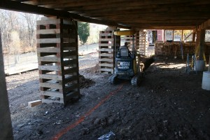 With the overshoot section of the frame still on dunnage stacks we begin excavating for the new forebay wall footings.