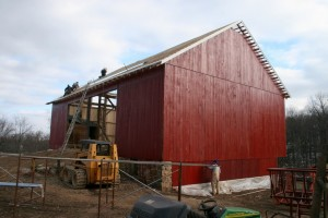 """Siding is painted with two coats of a natural linseed-oil based paint.  This red is very """"Green."""""""