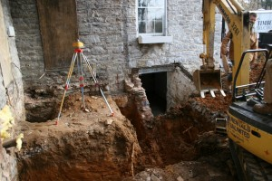 We'll excavate deeply enough to provide a secure footing well below frost and below the adjacent areaway floor.