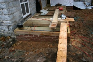 To properly support the reconstructed porch, we built solid piers with footings below the frost line.