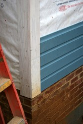 """The trim and siding are clear yellow pine for durability.  The siding is custom-milled """"dutch lap"""" pattern to match the original.  All wood is treated with linseed oil and painted with a traditional lindseed oil paint."""