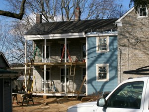 Siding complete and New Porch Posts Installed